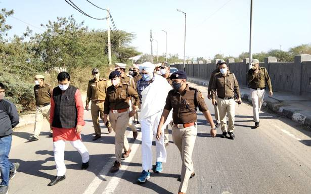 Farmers march live updates | Police move farmers to Burari grounds