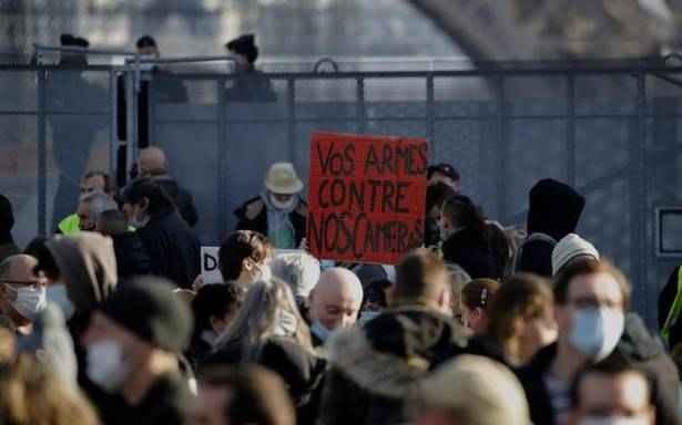 Protests staged across France against bill on police images