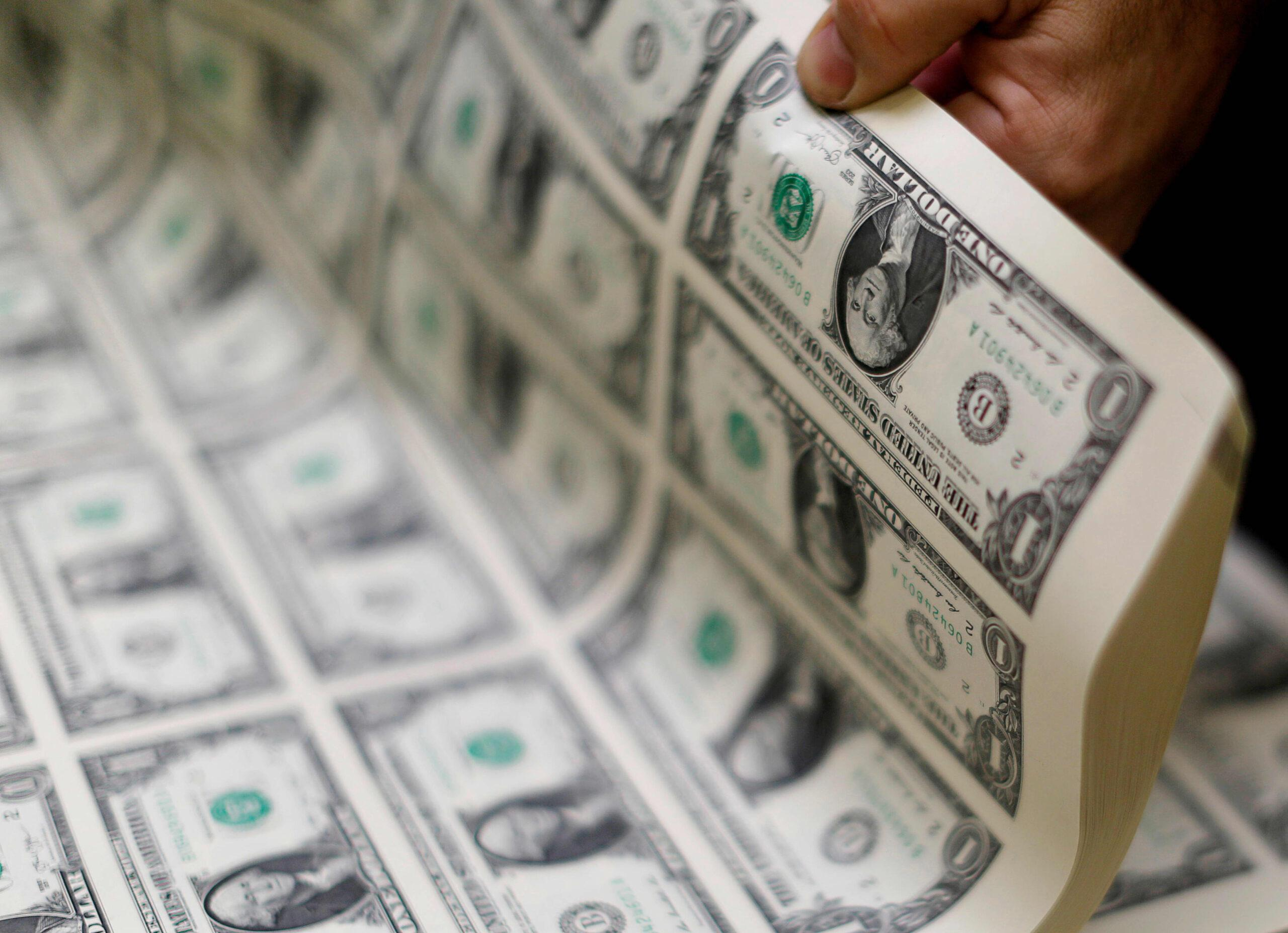U.S. dollar hovers around two-and-a-half year low; Analysts see further weakness in 2021